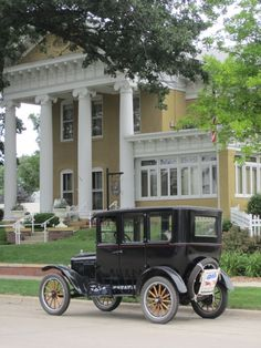 The Hormel Historic Home with a Model-T parked outside for a convention that brought in over 250 Model-Ts to Austin, MN
