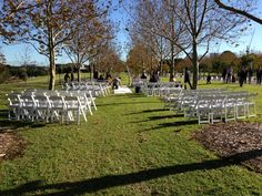 Ceremony setup at Bicentennial Park, The Treillage in between the trees. Ceremony decorated with a bridal arch, white carpet, white fold up chairs and silk flower balls for aisle chairs. Bicentennial Park, Fold Up Chairs, Types Of Wedding Cakes, Photography Ideas, Wedding Photography, Pew Ends, White Carpet, Flower Ball, Wedding Ceremonies