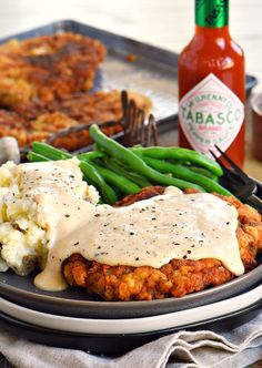 The Ultimate Chicken Fried Steak is fried to golden perfection and topped with the creamiest gravy you can imagine, sure to quickly become a family favorite. It's hard to imagine a more quintessential Southern meal than Chicken Fried. Steak Recipes, Chicken Recipes, Cooking Recipes, Copycat Recipes, Cuban Recipes, What's Cooking, Cooking Ideas, Chicken Fried Steak Gravy, Beef Steak