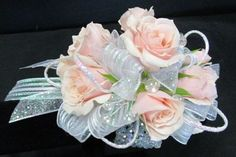 Pink Wrist Corsage with spray roses & baby blue iridescent ribbon