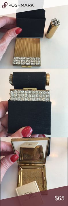 Vintage Zell Rhinestone Compact/Lipstick Case This embellished set includes a gold tone compact with a triple row of rhinestones and a matching embellished lipstick case. The interior of the compact reveals a beveled mirror and a powder compartment with an engraved floral design, complete with a Powderpuff.The lipstick case features and embellished rhinestone top. Both fit into a black carrying case. In lovely vintage condition, appears to have never been used. Vintage Accessories