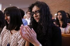 Yusra Siddiqui, right, and Zoha Ahmad, who came with others from the Islamic Society of Greater Chattanooga to offer their support, pray during an interfaith vigil at Olivet Baptist Church held in remembrance of victims of the July, 16 shootings on Friday, July 17, 2015, in Chattanooga, Tenn. The vigil was held one day after gunman Mohammad Youssef Abdulazeez shot and killed four U.S. Marines and wounded two others and a Chattanooga police officer. Photo by Doug Strickland /Times Free Press
