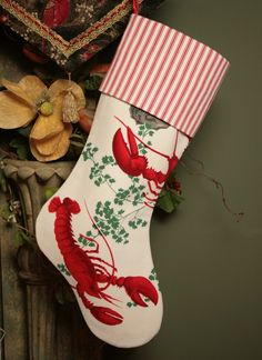 Christmas stocking sewn from vintage lobster tablecloth and red and white ticking