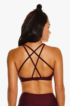"""Nimble Activewear Criss Cross Sports Bra // The higher the bun, the better the workout. Get #onthemove with us and receive 15% off your next order with the code """"PINTEREST15"""". Shop your new favourite activewear gear at www.nimbleactivewear.com."""