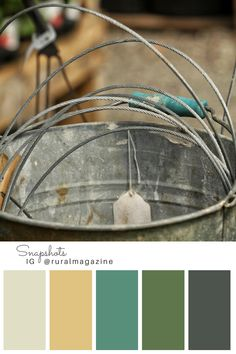 I'll be in the garden. Galvanized bucket with sales tag, and green toned color palette. From Rural Magazine's Instagram feed.