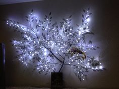 Lighted tree. Metal leaf pieces with LED fairy lights. And a chameleon hangin' out..