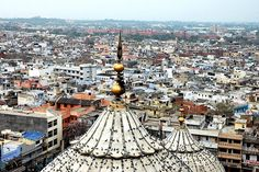 This is how India looks.  Bird's eye View of Old Delhi.   This photograph shows the most congested and busy part of Delhi. You can see the popular Red-Fort in the background too..