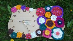 Handmade wooden clock designed with knitted flowers by LoveFor