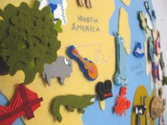 Felt wall globe... all the little pieces attach with velcro and it has a suitcase to hold them all... how fun!