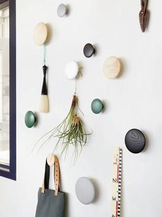 One of my favorite storage solutions for small spaces, or for any size space, is also one of the simplest: hooks