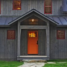 Exterior shiplap siding in a translucent stain, gives a gray weathered look that stands up to the elements and grows more beautiful with time.