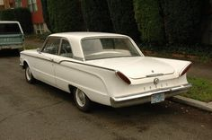 My first car. A red and white 1960 Mercury Comet Coupe.