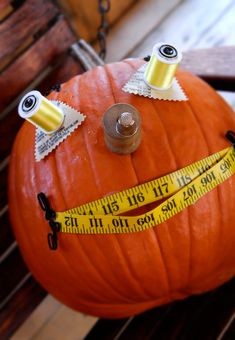 Decorate Pumpkins with Sewing Supplies - No carving your pumpkins this year! Just dig through your sewing stash to make these scrappy pumpkins perfect for a fall table or outdoor setting.