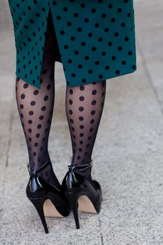 Polka dot tights and skirt, love the combo.