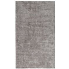 To complement or to contrast? Don't worry, our solid silver rug is effective either way. Hand-woven of 100% viscose for a silken feel, low profile and pleasant sheen, it's perfectly suited for bedrooms or formal areas—whether subtly enhancing your decor or making it really stand out.