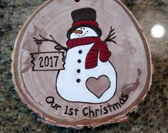 Santa Polar Bear wood burned ornament. These ornaments are made out of white birch wood gathered from fallen limbs on our (and our extended familys) property. No trees are cut down to make my ornaments. Painted portions of this ornament are sealed with a glossy finish. The two white portions on the Santa had have crystal glitter on them. Approximate dimensions: 2.25 wide, 2.5 tall. Each wood disc has its own natural markings, bark and imperfections. These ornaments are rustic and add a…
