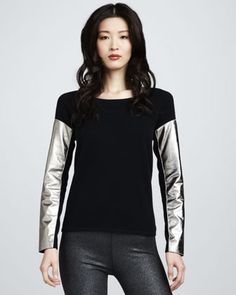 Aiko sweater with metallic leather sleeves.