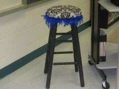 a feather boa glued to the bottom of a stool - super cute way to add a pop of color!
