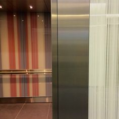 Red, white and blue: Our custom ViviGraphix glass adorns this LEVELe Elevator Interior at Block 300 in Portland.
