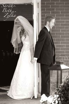 praying with Phill on either side of a door before the wedding