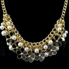 """FAUX PEARL AND BLACK FLOWER NECKLACE Flowers and pearls(faux) 9""""Length. Gold tone. Wear this from day to night. All year around. Timeless. -No trades. Jewelry Necklaces"""