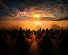 """""""If you visit there at the right time, you can see surrounding fog and additional couples of volcanoes in sight,including Mt.Merapi. The picture looks surreal but actually everything is all real. I use graduate ND filter and some color processing for mysterious emotion""""  Borobudur by Weerapong Chaipuck"""