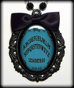 Ouija board necklace.