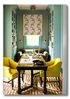 beautiful office, love the shade, the turquoise shelves the comfy yellow chairs and the velvet (?) love seat under the window.