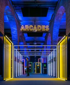 madrid's 'game on' exhibition celebrates the history of video games History Of Video Games, 80s Video Games, Exhibition Display, Exhibition Space, Stage Design, Event Design, Embodied Energy, Light Tunnel, Brick Arch