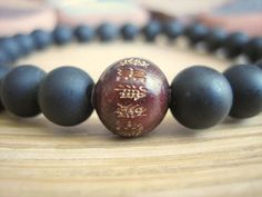 Mens Mala Bracelet with matte Black Stone and Heart Sutra engraved red Sandalwood bead