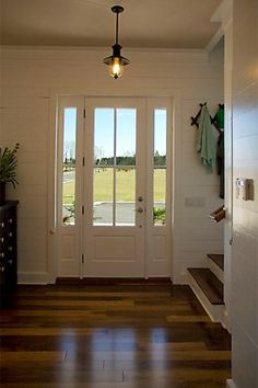 Glass front door lets natural light in.