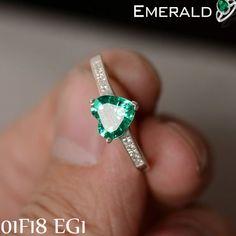 Adorn designer pair of emerald earring to look classy.