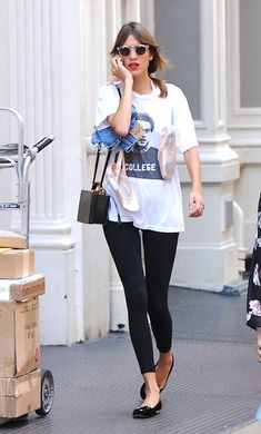 15 stylish ways to wear a t-shirt: Alexa Chung pairs her t-shirt with black leggings and flats