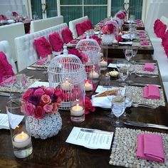 Wedding table setting - white, pink, birdcages, candles.