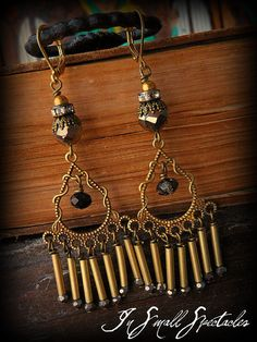 Solid brass tube beads are endcapped in small faceted mercury czech glass beads and dangle from solid brass filigrees. Topping it are 8mm
