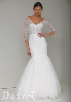 Gown features corset bodice.