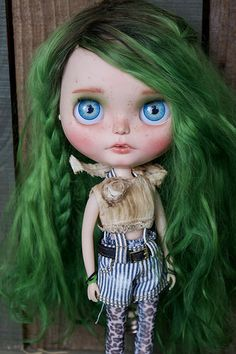 708cbd22b85 Micah Blythe Doll Dark With Green Hair. Blythe is a fashion doll, with an  oversized head and large eyes that change color with the pull of a string.