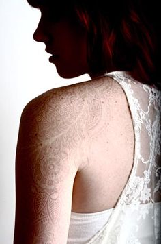 White ink tattoo on a redhead - thinking seriously about T's name in white ink. Maybe with a design. Somewhere discreet.