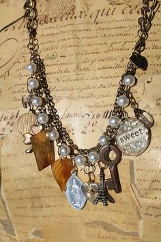 This is so AWESOME... a charm bracelet + a little extra chain = a FABULOUS necklace!!!