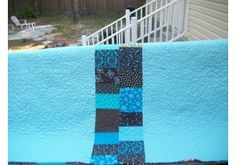 The back of my brown and turquoise quilt.