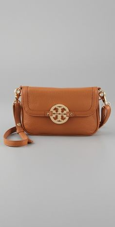 i just need to become Tory Burch's personal purse tryer.