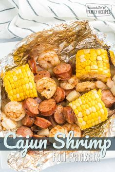 We love grilling up Cajun Style Grill Foil Packets. We can't get enough of the Cajun flavors with the grilled corn and sausage and shrimp, and there is NO MESS! #grillrecipes #shrimpfoilpackets #shrimprecipe #shrimp #foilpackets #foilpacketrecipe #campingrecipe #grilledcorn #cajunrecipe #cajunshrimp Shrimp Foil Packets Oven, Grilled Foil Packets, Cajun Recipes, Seafood Recipes, Healthy Recipes, Healthy Dinners, Seafood Meals, Meal Recipes, Seafood Dishes