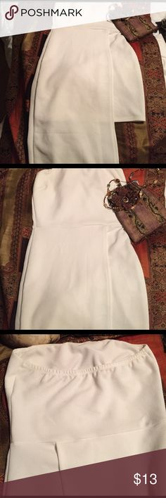 White strapless dress Has padding in bust. Worn a few times! Pictures don't do dress justice. Ktoo Dresses Midi