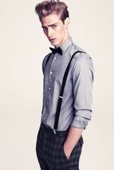 Grey shirt looks so cool when you add black suspenders and a bow tie