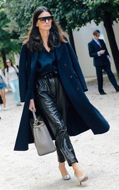 Leather pants, blue top, navy oversized coat, pale gray purse