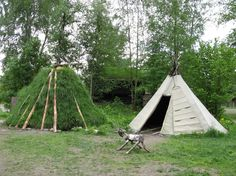 Traditional goahti sod home and lavvu tent of the Sami people native to northern Scandinavia at the Norsk Folkemuseum.