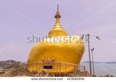 Phuket, Thailand - April 25, 2016 : The replica of Phra That In-Kwaen (Hanging Golden Rock) at Koh (islands) Sirey temple, Phuket, Thailand. It was built by Myanmar Buddhists who work in this region.