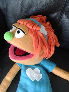 I love this idea with fleece for the puppet hair!