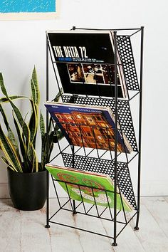 Could be good for LPs. Easy to thumb through? But no record player holder. Corner Store Record Rack from Urban Outfitters
