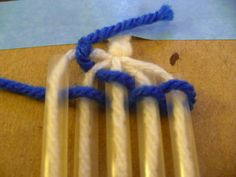 Weave the yarn over and under the straws.  Keep the weaving as tight as possible.  As the straws become wrapped  in yarn, slide the straws down to re-expose them.  Continue weaving  until your  piece reaches the desired length.